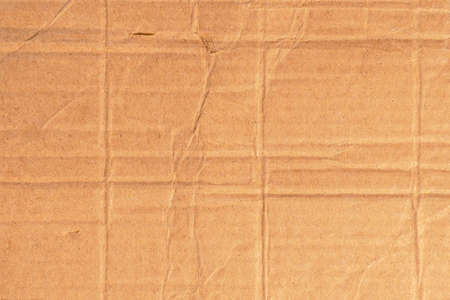 Corrugated crumpled packing carton for delivery. Background for design Stock fotó