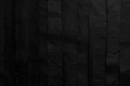 Abstract black background. Wrinkled stripes of black old material Stock fotó