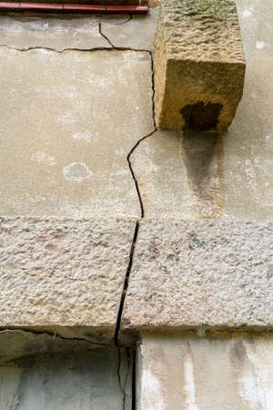 Wall crack of a destroyed building closeup. Breach from an artillery shell hit. The concept of destruction from armed conflicts and wars Stock fotó