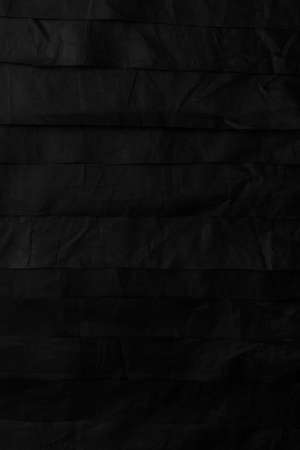 Black abstract striped background from pieces of synthetic crumpled material Stock fotó
