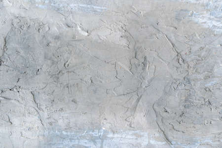 Grungy gray cement background with old scratched texture. Фото со стока