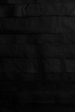 Abstract background from stripes of black material
