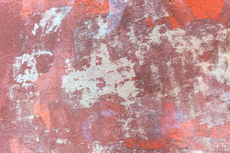 Plastered wall with a dirty red brown. Abstract horizontal background. Rusty texture painted over and covered with cement