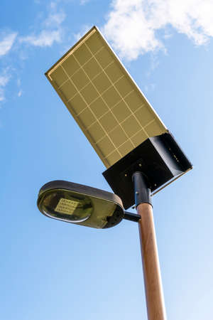Solar powered street lamp pole close-up against the sky. Renewable alternative energy concept Stock fotó