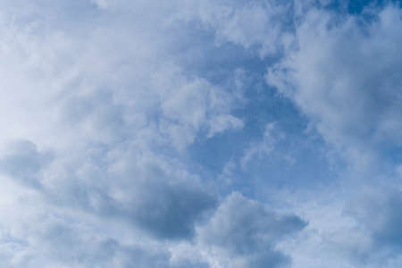 Cloudy bright blue sky with clouds