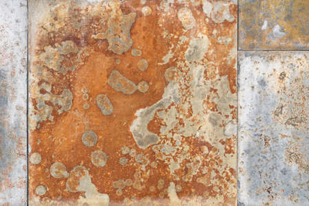 Rusty mottled peeling corroded texture. Abstract background