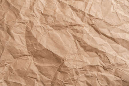 Abstract wrinkled wrinkled texture of wrapping brown paper. Abstract background