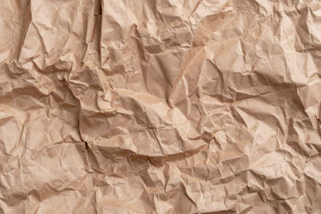 Textured surface of recycled packaging wrapping crumpled paper. Copy space. Empty blank