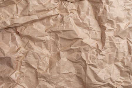 Crumpled wrinkled wrapping paper with abstract texture. Empty blank Фото со стока