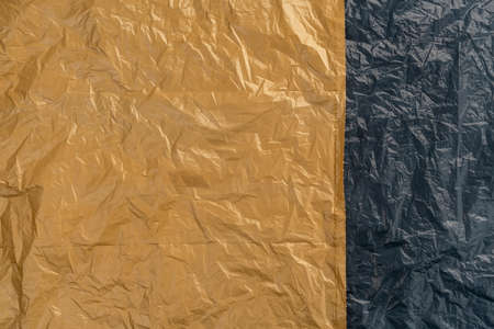Texture of the old crumpled garbage bag. Copy space. Abstract background. Environmental pollution and conservation concept