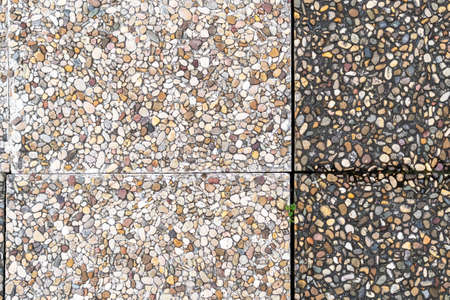 Pebble stone in outdoor tiles with geometric shapes. Close-up. Copy space