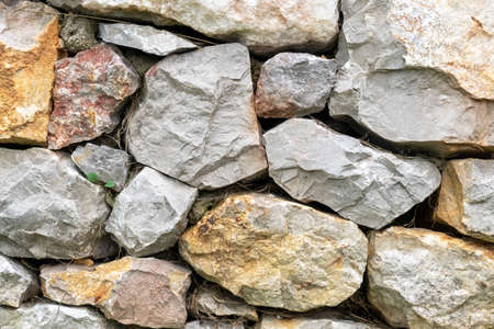 Stacked natural stone wall texture. Texture rocky natural architectural background