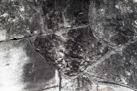 Rotten stone wall with black mold. Abstract destruction background