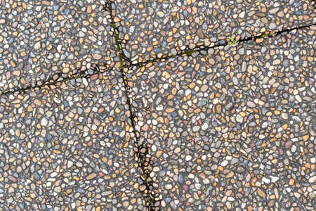 Pebble stone in outdoor tiles with geometric diagonal shapes. Close up. Copy space Фото со стока