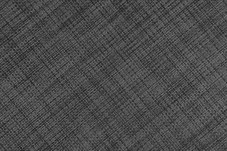 Textured gray black braided plastic material with a diagonal geometric weave. Abstract dark background Фото со стока