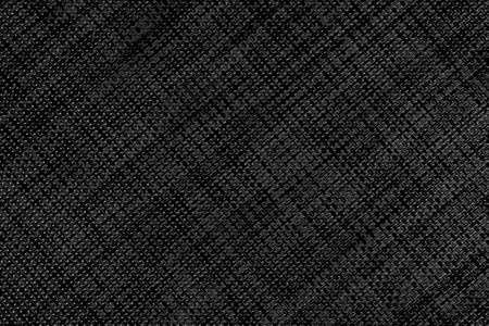 Black abstract textured wicker surface with a diagonal geometric pattern. Dark embossed background