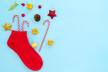 Christmas composition.  Red christmas stocking with decoration on blue background.  Creative flat lay, top view design Stock Photo