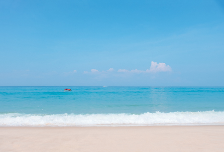 Beautiful blue ocean wave and jet ski on tropical beach. Sandy beach with sea and blue sky background. Summer, holiday -Image