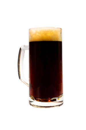A mug full of dark beer. isolated on a white background. Stock Photo