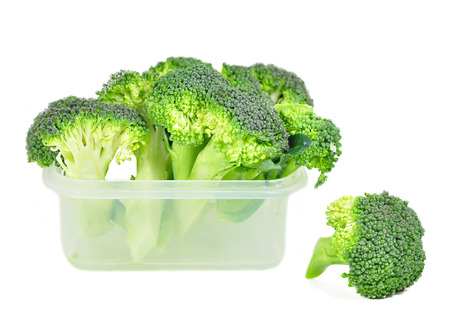 Broccoli in a plastic container with white background photo