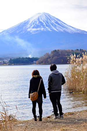 KAWAGUCHIKO, JAPAN - December 6, 2015 : Unidentified people standing near Kawaguchiko Lake with Mt. Fuji background. Editorial