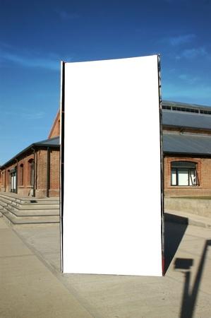 billboard posting: Outdoor blank billboard on city background
