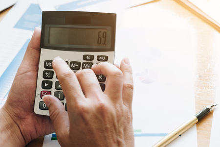 Hand using calculating, Professional investor and financial working in office ,Business marketing concept
