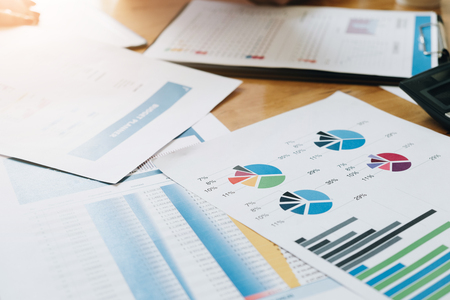 Financial data and marketing growth report graph paperwork in workspace, Business marketing and finance concept