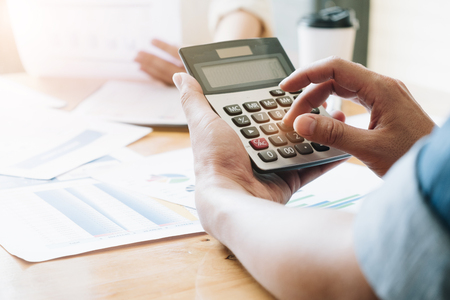 Hand using calculating, Professional business team investor and financial working in office ,Business marketing concept