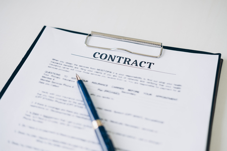 Pen and Insurance contract document sheet and business document in home office, Business and Office concept.