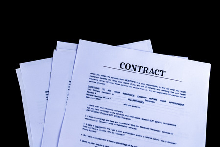 Legal Contract Agreement Documents Papers with black background and top view, Business and Office concept.