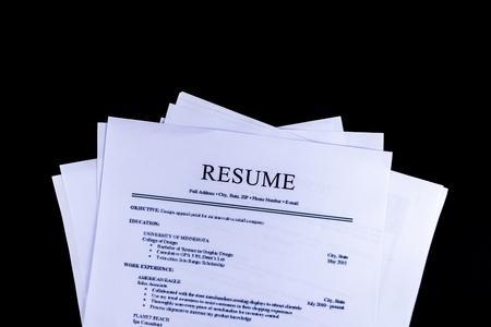 Resume Documents Papers with black background and top view, Business and Office concept. Standard-Bild