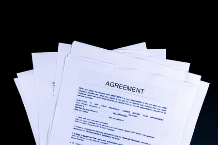 Agreements Documents Papers with black background and top view, Business and Office concept.