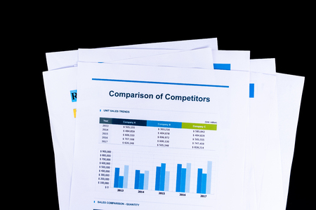 Competitor Comparison Analysis and market research sheet documents papers with black background, Business and Office concept.