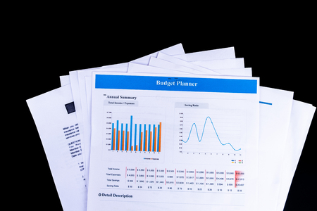 Budget Planner balance sheet documents paper with black background and top view, Business and Office concept. Standard-Bild