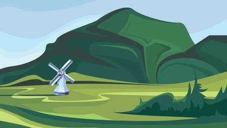 Windmill on the background of green mountains.