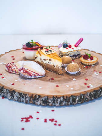 Mix of Sweet valentine's day cakes on wooden table for your love