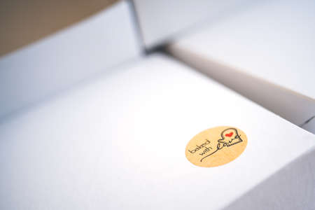 White paper box for cake and symbol backed with love