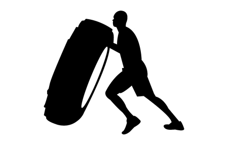 Strong, young man rolling a heavy tire silhouette