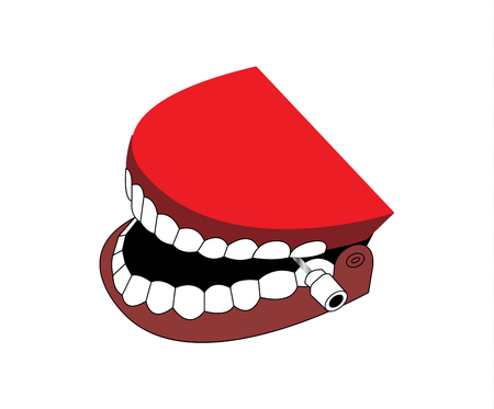 Fake teeth toy on white background