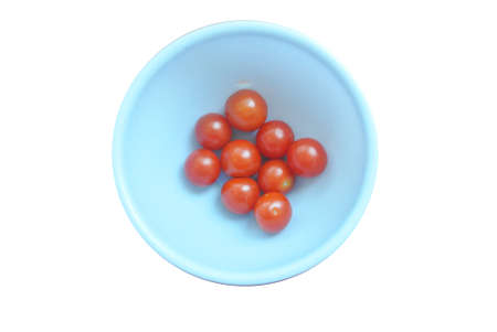cherry tomatoes on a plate isolated