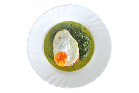 spinach and egg on plate isolated