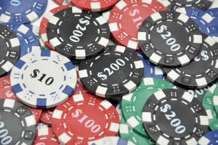 A large stack of poker chips photo