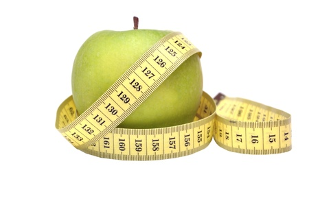 Green apple and tape measure Stock Photo - 15872828