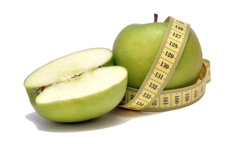 Green apple and tape measure Stock Photo - 15872826