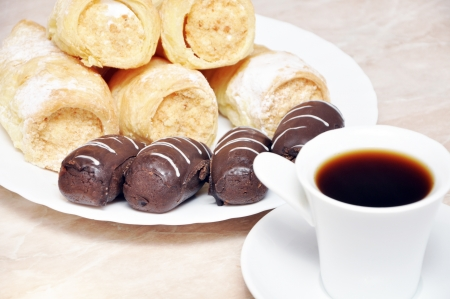 Puff pastry rolls with cream, chocolate and coffee potatoes Stock Photo - 17396955