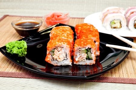 Japanese rolls with masago caviar, cheese and cucumber photo