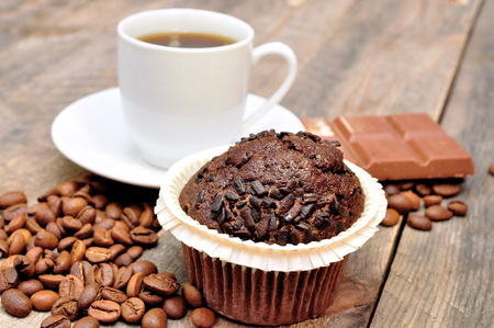 cup of coffee with muffin and chocolate Stock Photo