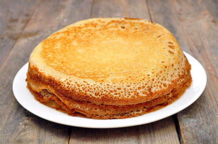 eat smeared: pancakes on a plate on a wooden table