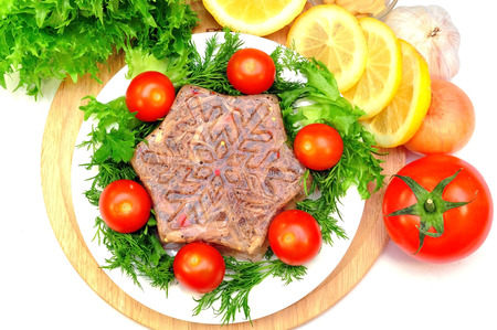 Aspic from meat with lemon, mustard and fresh vegetables photo
